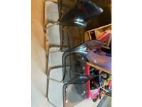 4 acrylic chairs with chrome legs and framework.