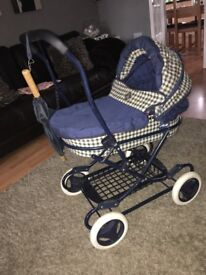 Toy pram with baby