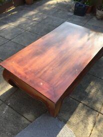 Beautiful solid Indonesian dark teak coffee table with opium legs