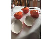 Le Creuset casserole and pan set orange.