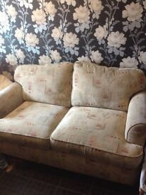 Ortherpeidic two seater sofa bed with matching chair really comfortable and still in good gondition
