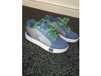 Sidewalk blue wheeled skate shoe