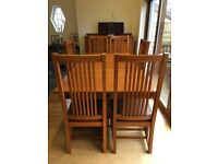 House of Frasers Marlow Dining Table, 4 Chairs, 2 Carvers and Sideboard.
