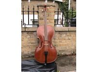 Full sized cello with a bow and cover