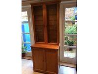 Solid oak dresser/display cabinet, glazed front, 7 glass shelves, 2 shelves in base.
