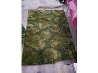 Green sculptured rug 120cm by 170cm