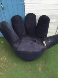 Adult hand shaped swivel chair