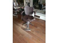3 Brown salon chairs.
