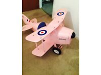 Kids pink custom made aeroplane 4ft in length with peddles and pilot stick. Hardly used £180