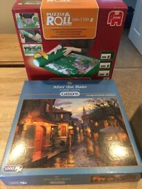 Jigsaw puzzle (unopened) and puzzle roll unused. Could be a Christmas present as new