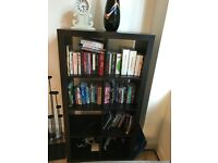 Black wooden bookshelf - can stand upright or on its side