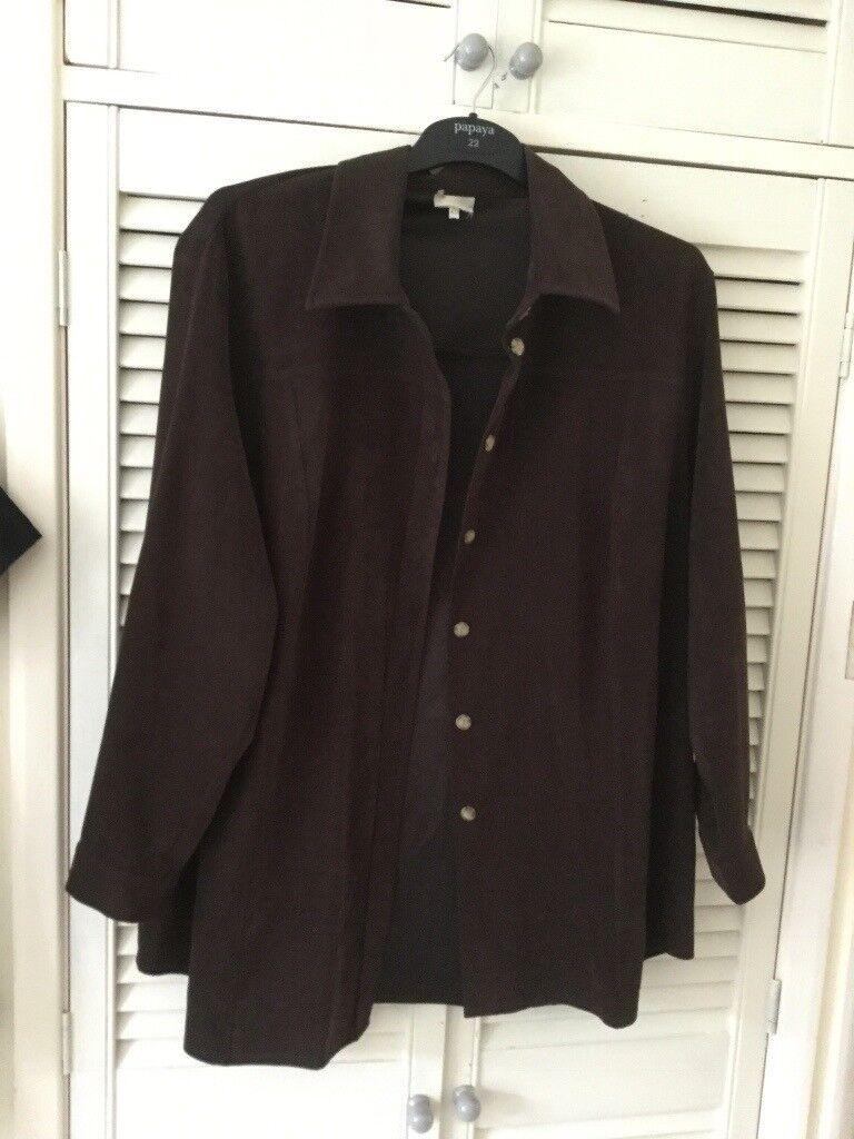 Suede effect over shirt/jacket.