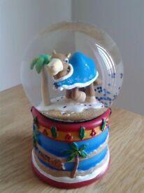 Camel snow globe