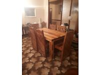 Dining table and six chairs solid wood ex gillies