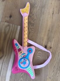 Fully working toy guitar.