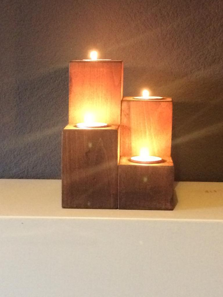 Recycled wooden candle holders.
