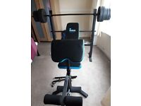 Weight bench with preahcer curl and leg extension functions