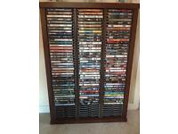 Dark oak DVD stand with all the DVDs