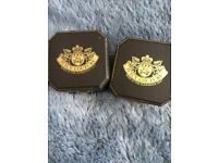Two juicy couture charms