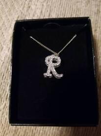 Avon silvertone initial R necklace