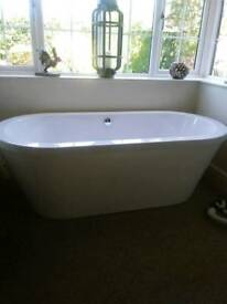 Free standing bath with fittings