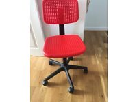 Red IKEA chair near new