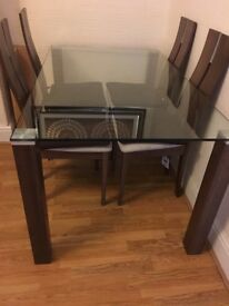 Elegant glass dining table and 4 chairs