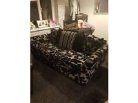 2 black and grey 3 seater sofas