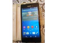 Sony Xperia E2303. Black in white case. Android version 5.