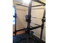 Squat rack/utility bench and Olympic weights