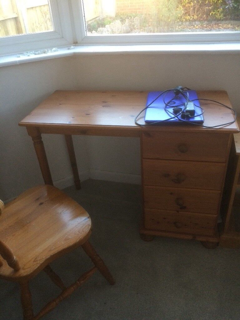 Wooden desk with drawers and chair