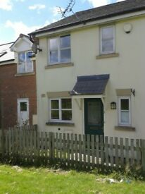 Unfurnished Two bed mid terrace house with garage