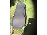 Black nearly new sun lounger for sale