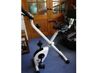 Exercise bike, folding for easy storage, computer read out