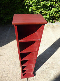 Very well made solid mahogany finish CD/DVD storage unit.