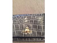 Authentic Vivienne Westwood purse,needs some repair as catch has come away from the fabric,only £4!