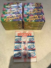 24 packs of 12 PARTY POPPERS + 6 PACKS 24 B/DAY CANDLES