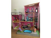Large Wooden KidKraft Dolls House with Swimming Pool and furniture.