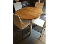 small extendable table and four chairs