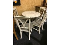 Small marble round table and four never used chairs