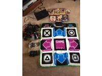 PS2, 2x controllers, Dance Stage MegaMix & mat, Buzz & buzzers & games