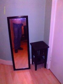 full length black framed mirror