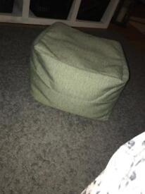 Green cushioned foot stool