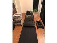 PlayStation 3 500GB - 3 pads - 20 games hardly used