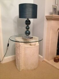 Small stone effect glass top table with matching oval coffee table.