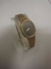 Ladies 9ct Gold Omega Watch with a black oval dial. Weight 30g, in Working order.