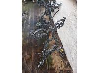 SUPER PAIR OF METAL TABLE ENDS VERY DECORATIVE WOULDMAKE SUPER TABLE