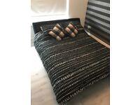 Roma Italian design black leather kingsized bed.