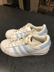 White and light blue Adidas Superstars size 6