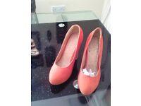 New orange retro shoes size 6.